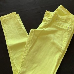 Express yellow skinny jeans